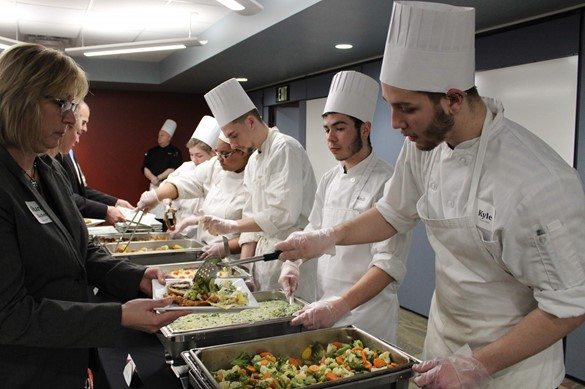 Culinary students serving on a buffet line