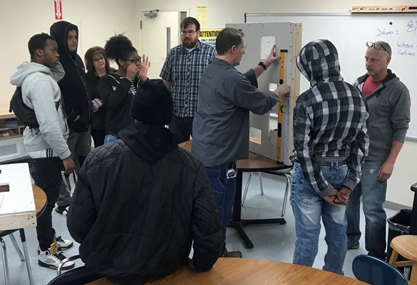 Alt High students learning how to work with drywall in their STEM class