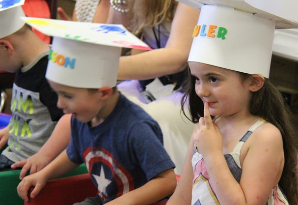 Preschool students at their graduation ceremony