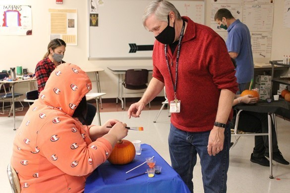 Painting pumpkins at Westside Jr./Sr. High Academy