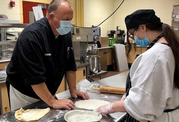 Chef and CTE student baking a pie