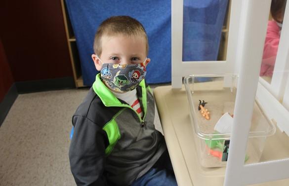 Pre-schooler wearing a mask