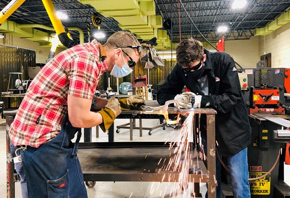 Instructor and student working in the CTE welding lab