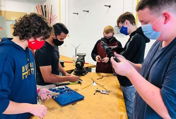 Five students working at CTE