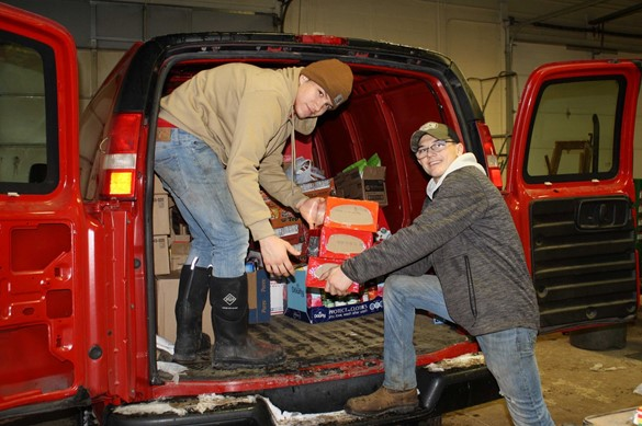 CTE students loading donations into a van