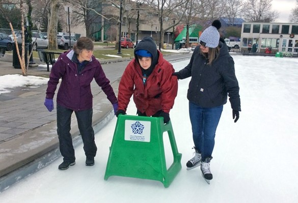 Two therapists and student skating in downtown Rochester
