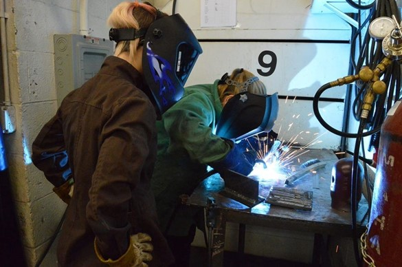 Two students welding