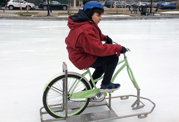 Student using special ice bike at the skating rink