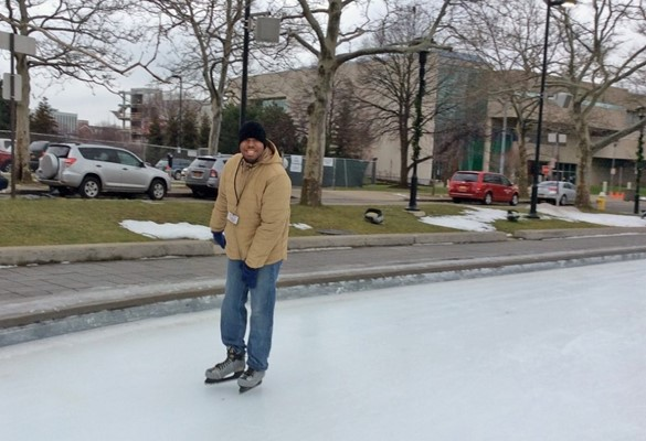 Student skating in downtown Rochester
