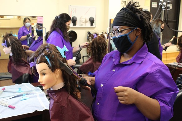 Students at CTE styling hair
