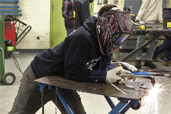 Student welding at CTE