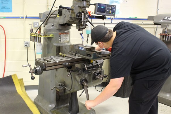 Student in the machine shop at CTE