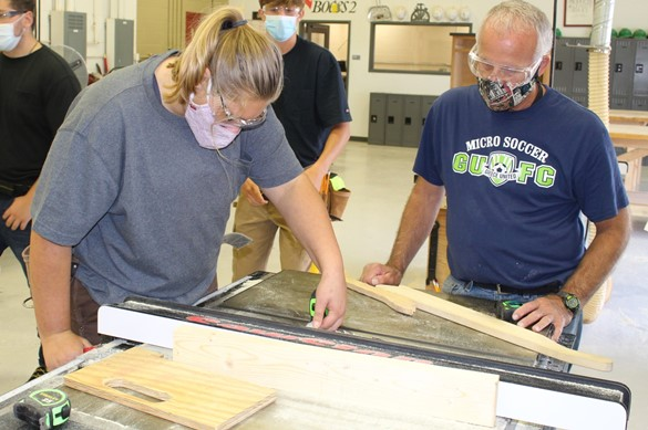 Student and staff member working in the carpentry shop at CTE