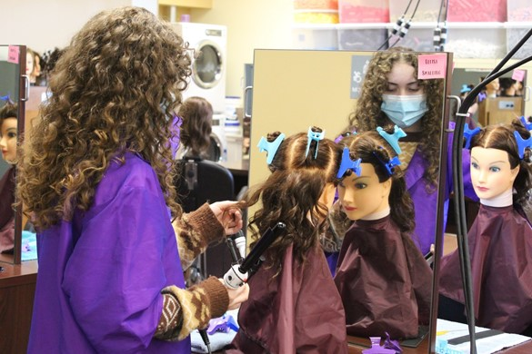Student styling hair at CTE