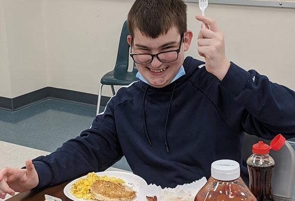 Westview student eating breakfast