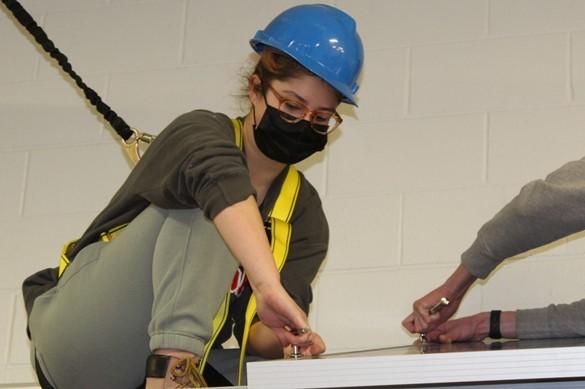 CTE student installing solar panel