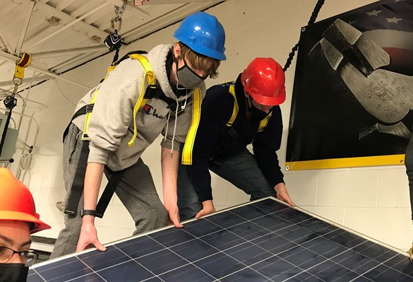 CTE students installing solar panel