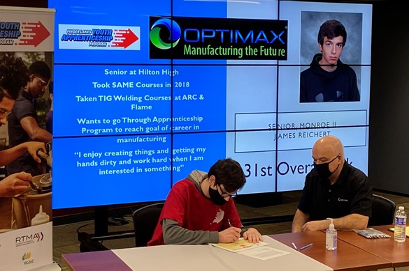 Student signing for the Finger Lakes Youth Apprenticeship Program