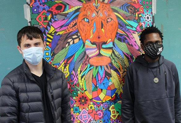 Two students with artwork at Paul Road Transition
