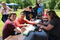 students getting temporary tattoos at fun fair