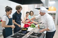 Students working in a professional kitchen